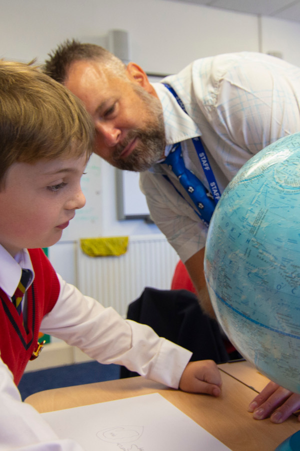 Charlton House Teacher with a student and a globe